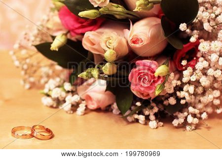 Two gold rings with Greek ornaments and Bridal bouquet