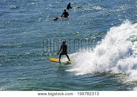 Surfer on Copacabana beach in Rio de Janeiro