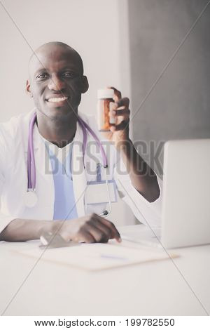 Close-up of male doctor giving jar of pills to patient. Doctor. Pill.