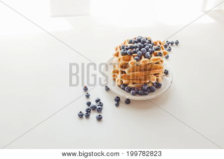 Plate Of Fresh Crunchy Waffles With Blueberries