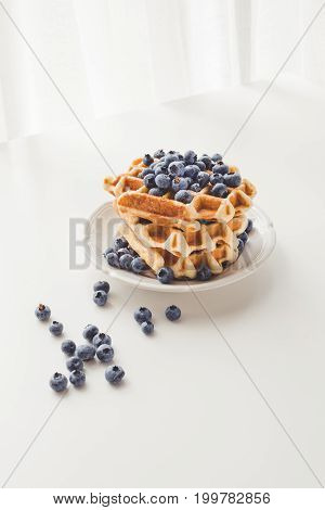 Plate With Stack Of Tasty Fresh Waffles With Blueberries