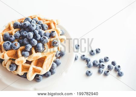 Plate Of Tasty Stacked Waffles With Blueberries
