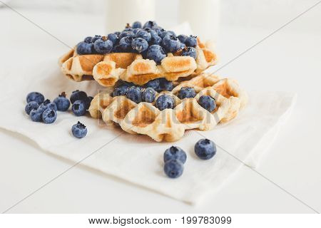 view of delicious waffles with blueberries for breakfast
