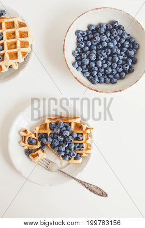Composition Of Waffles And Blueberries In Plates For Breakfast