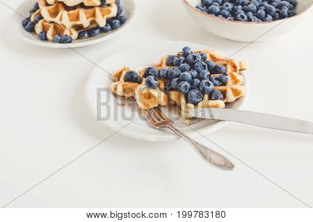 Composition Of Waffles And Ripe Blueberries For Breakfast