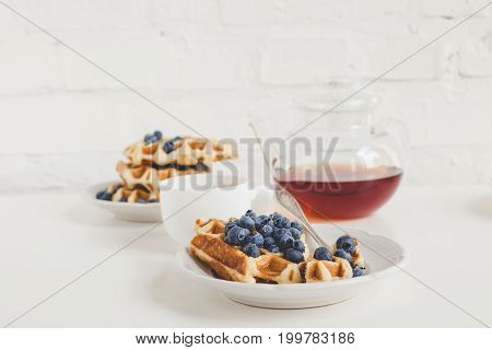 Delicious Breakfast Of Freshly Baked Waffles With Blueberries And Tea