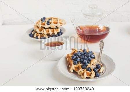 Delicious Breakfast Of Belgian Waffles With Blueberries And Tea