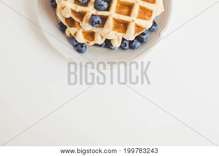 Top View Of Tasty Fresh Waffles With Blueberries With Copy Space