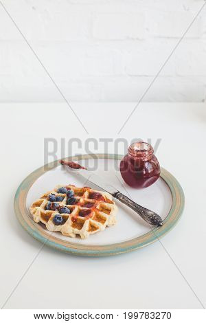 Waffle With Jam, Blueberries And Vintage Knife On Plate