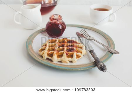 Delicious Waffle With Jam, Blueberries And Knife On Vintage Plate