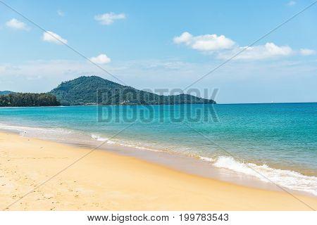 Dream scene. Beautiful tree over white sand beach. Summer nature view Si milan Thailand