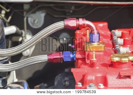Diesel racing car engine with tube and fitting