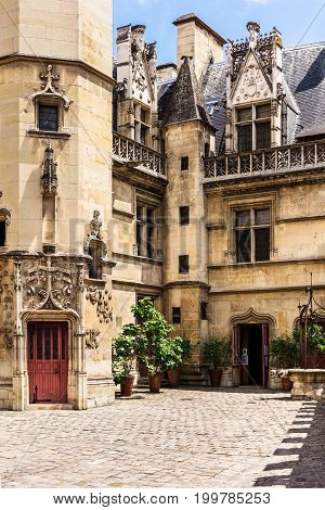 View of the courtyard of the Cluny museum (Musee de Cluny) or National Museum of the Middle Ages (Musee national du Moyen Age) in the Hotel de Cluny. The Musee de Cluny houses a variety of important medieval artifacts. Paris France