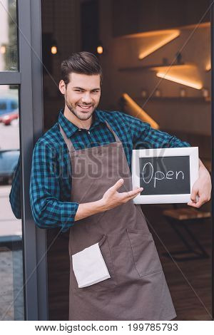 Barista Pointing At Chalkboard With Open Word