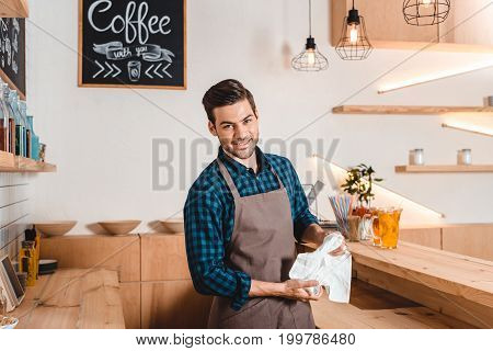 Smiling Barista In Coffee Shop