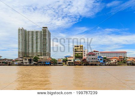 Picture of the houses along the Chao Phraya River when flood tide.