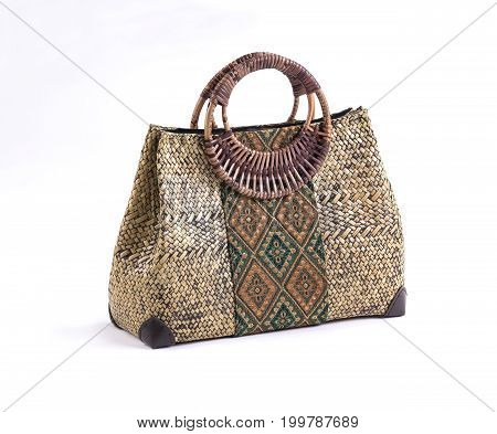 Beautiful wicker handbag decorated with Thai fabric style and rattan handles