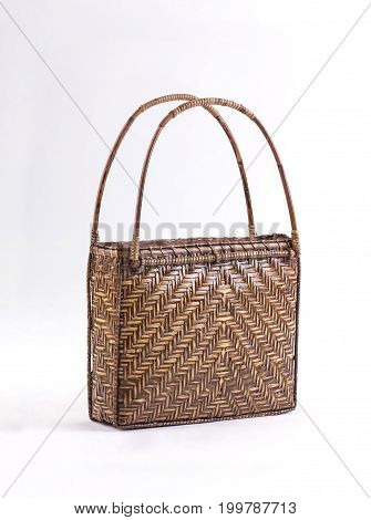 Bamboo handbag with rattan handles isolated on white background