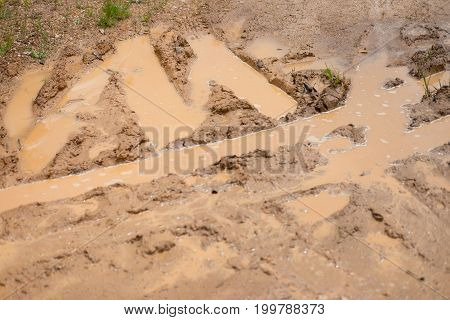 Close up road wet muddy of countryside