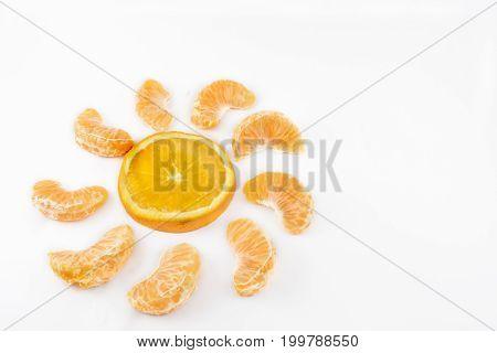 Sun formed by orange and mandarin segments. White background.