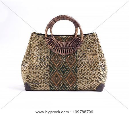 Beautiful wicker handbag decorated with Thai fabric style isolated on white background
