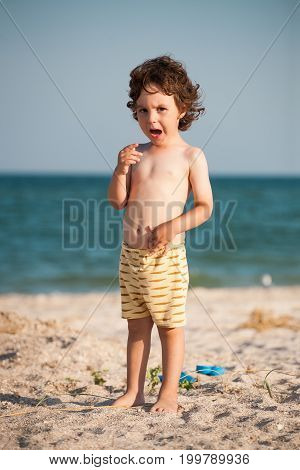 Crying Boy On The Beach.