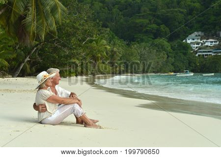 Happy elderly couple  relaxing on  tropical beach
