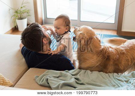 Family Having Fun With A Feeding Bottle