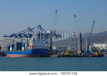 International sea port of Novorossiysk. Cranes loading cargo ship