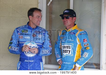 August 11, 2017 - Brooklyn, Michigan, USA: Clint Bowyer (14) and Kevin Harvick (4) hang out in the garage prior to practice for the Pure Michigan 400 in Brooklyn, Michigan.