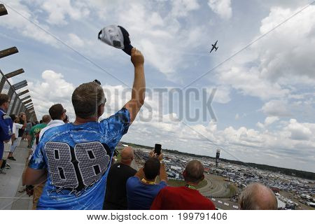 August 13, 2017 - Brooklyn, Michigan, USA: A fan holds his hat in the air during the flyover for the Pure Michigan 400 at Michigan International Speedway in Brooklyn, Michigan.