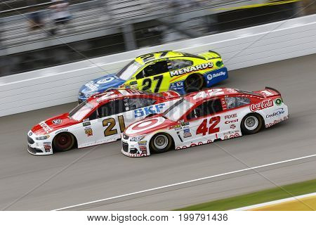 August 13, 2017 - Brooklyn, Michigan, USA: Kyle Larson (42), Ryan Blaney (21) and Paul Menard (27) battle for position during the Pure Michigan 400 in Brooklyn, Michigan.