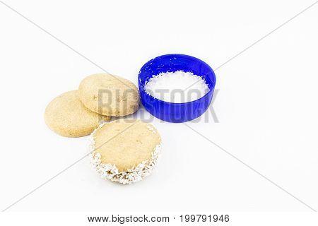 Alfajor of cornstarch dulce de leche and grated coconut.