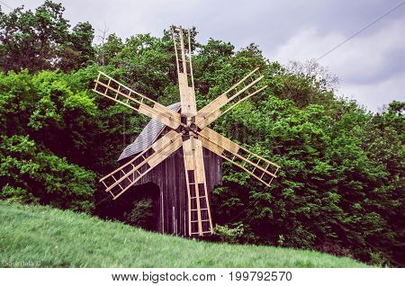 Ukranian wood windmill with light vanes, rural expanses in outdoor museum in Kiev