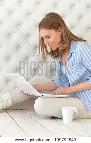 Portrait of beautiful young woman with modern laptop
