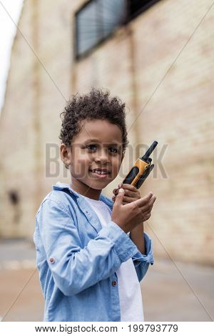 Beautiful Smiling Afro Boy With Portable Radio Set