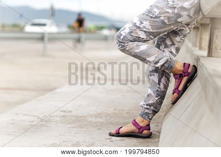 Woman traveller is walking stand on footpath