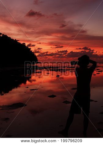 Photographer Shooting Seascape With Twilight Sky