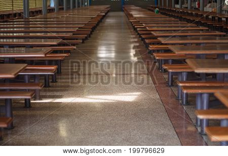 The corridor in the cafeteria with tables on both sides.