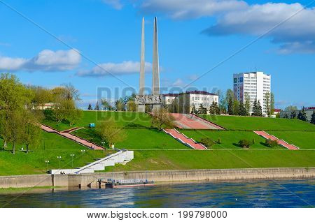 VITEBSK BELARUS - MAY 16 2017: Embankment of Western Dvina River and memorial complex in honor of Soviet soldiers-liberators partisans and underground workers of Vitebsk region (