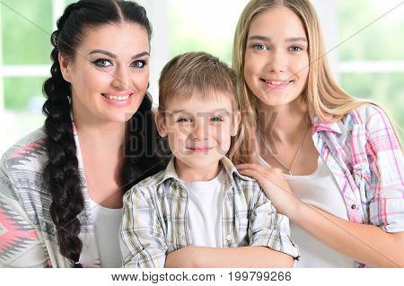 Portrait of brunette woman with two adorable children