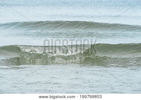 calm sea surf formation focus on front wave