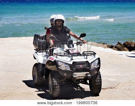 Greece, The island of Zakynthos 12.06.2017 .   Man and woman on the ATV. Walk to the sea on the island of Zakynthos