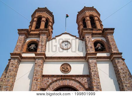 A frog perspective of the twin towers of the church in Pitillal, Puerto Vallarta, Mexico