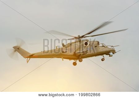 Military Helicopter With Weapons In The Sky