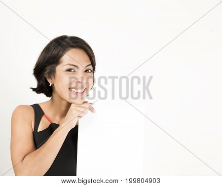 Beautiful Young Woman Holding A Blank Sheet Of Paper