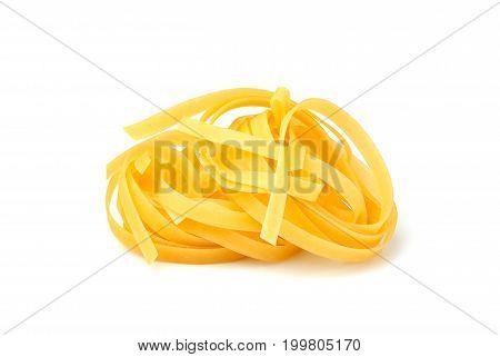 Fettuccine Italian pasta isolated closeup on white background.