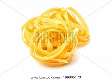 Raw dry tagliatelle pasta isolated on white background.