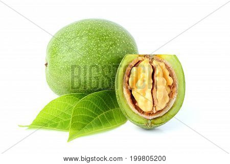 Young walnuts with leaves isolated on white background