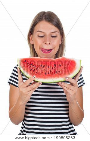 Picture of a healthy young woman eating a big slice of delicious watermelon posing on isolated background